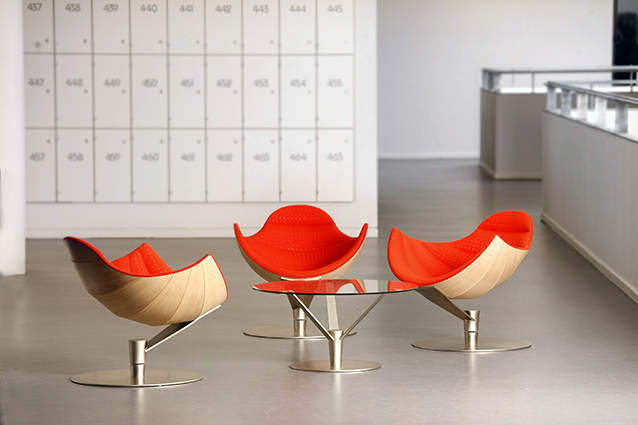 Shelley lounge chair designed by lund & paarmann orange and oak
